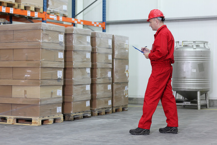 A worker checking stocks in a company warehouse